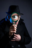 Detective with magnifier glass Royalty Free Stock Image