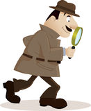 Detective with magnifying glass Stock Photography
