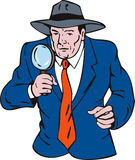 Detective with magnifying glass Royalty Free Stock Photography