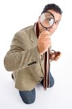 Detective and magnifying glass Stock Images
