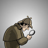 Detective with a magnifying glass Royalty Free Stock Image