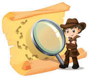 Detective and magnifying glass Royalty Free Stock Photos
