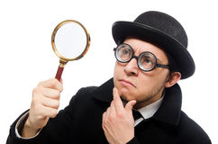 Detective with magnifying glass  isolated on white Royalty Free Stock Photo