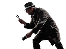 Detective man criminal investigations  silhouette. One detective man criminal investigations investigating crime in silhouette on white background Royalty Free Stock Photography