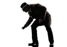 Detective man criminal investigations  silhouette. One detective man criminal investigations investigating crime in silhouette on white background Royalty Free Stock Image