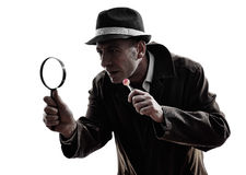 Detective man criminal investigations  silhouette Royalty Free Stock Images