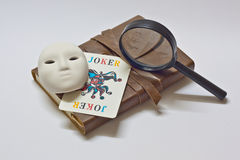 Detective notebook & joker Royalty Free Stock Photography