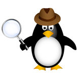 Detective penguin with magnifying Stock Photography