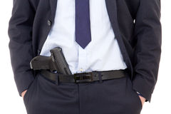 Detective, policeman or bodyguard with gun in pants isolated on Stock Image