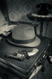 Detective ready to go. Detective equipment with briefcase, hat and gun, vintage interior on background stock photos