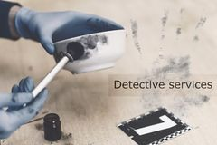 Detective services. Specialist conducting searches and takes samples of fingerprints at the crime scene. Investigation Stock Photography
