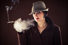 Detective smoking a cigarette Royalty Free Stock Photo