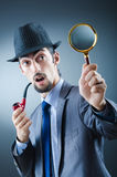 Detective with the smoking pipe Stock Image