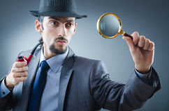 Detective with the smoking pipe Stock Photography