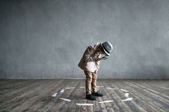 Detective in studio. Searching boy in a studio royalty free stock photography