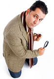 Detective with tobacco pipe and magnifier Stock Photography