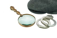 Detective Warm Cap, Retro Magnifying Glass and Real Handcuffs Stock Photo