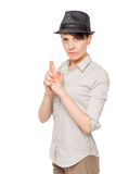 Detective woman thumbs gun on a white background Stock Images