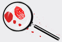 Detectives Magnifying Glass. A magniying glass exanining a finger print and blood splatter Stock Photography