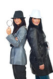 Detectives women with hats Stock Photos