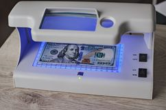 Detector banknotes and money US dollar royalty free stock photos