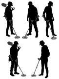 Detectorists-Schattenbild auf weißem Hintergrund Stockfotos