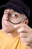 Detektiv mit Vergrößerungsglas stockfotos