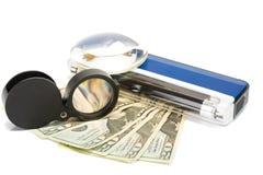Detektor mit Geld lizenzfreies stockfoto