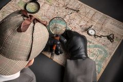 Detektyw i mapa Londyn Zdjęcia Royalty Free