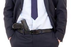 Detektyw, policjant lub ochroniarz z pistoletem w spodniach odizolowywających dalej, obraz stock