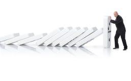 Detención de un efecto de dominó Fotografía de archivo