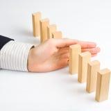 Detención del efecto de dominó Fotografía de archivo