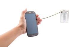 Deteniendo el teléfono y a Tin Can Telephone elegantes I Imagen de archivo
