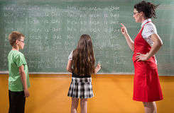 Detention. Female techer looking  to her students with severe attitude Stock Images