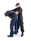 Detention. Handcuffed men being escorted by the policeman Royalty Free Stock Photography