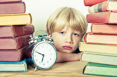 Detention. School boy having to stay late at school stock image