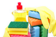 Detergent bottle, gloves and cleaning sponge Royalty Free Stock Photo