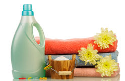 Detergent in bottle and towels Stock Photos