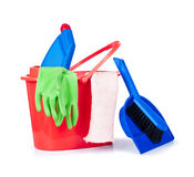 Detergent bottles, brushes, gloves and sponges in bucket Stock Photo