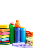 Detergent bottles and cleaning sponge. Royalty Free Stock Photo