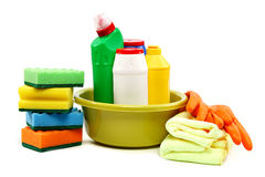 Detergent bottles, rubber gloves and cleaning sponge. Royalty Free Stock Images