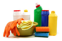 Detergent bottles, rubber gloves and cleaning sponge. Royalty Free Stock Image