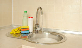 Detergent bottles and sponges Stock Photo