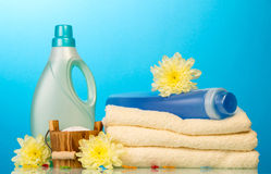 Detergent in bottles and towels Stock Photo