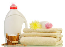 Detergent in bottles and towels Stock Photos