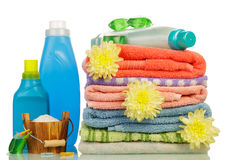 Detergent in bottles and towels Royalty Free Stock Photography