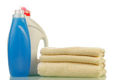 Detergent in bottles and towels Royalty Free Stock Images