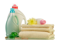 Detergent in bottles and towels Royalty Free Stock Image