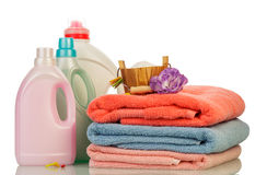 Detergent in bottles and towels Royalty Free Stock Photos
