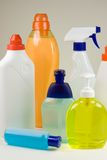 Detergent containers. Colored plastic detergent containers on grey background Royalty Free Stock Photos